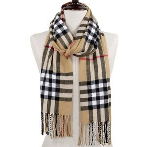 Tan Plaid oblong scarf with fringes.